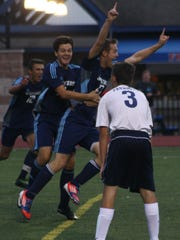 Stevenson players celebrate Conrad Kean's game-tying goal Monday night.