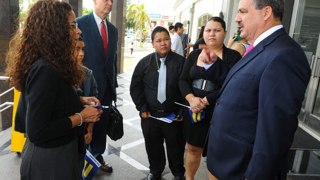 Attorney Todd Thompson, right, speaks with his collegues, supporters and same-sex partners, Loretta Pangelinan and Kathleen Aguero, at the entrance of the U.S. District Court of Guam building in Anigua on June 5.Rick Cruz/Pacific Daily News/rmcruz@guampdn.com
