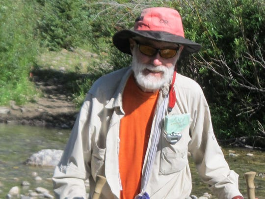 """David Cameron, 80, """"soldiering"""" across a stream in the Bob Marshall Wilderness this summer."""