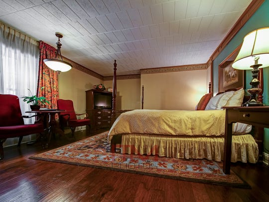 The Olde Mill Inn has luxury accommodations and rooms overlooking English gardens.
