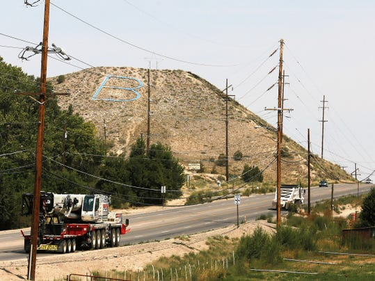 Power lines cross Thursday along U.S. 550 on the north side of Bloomfield.