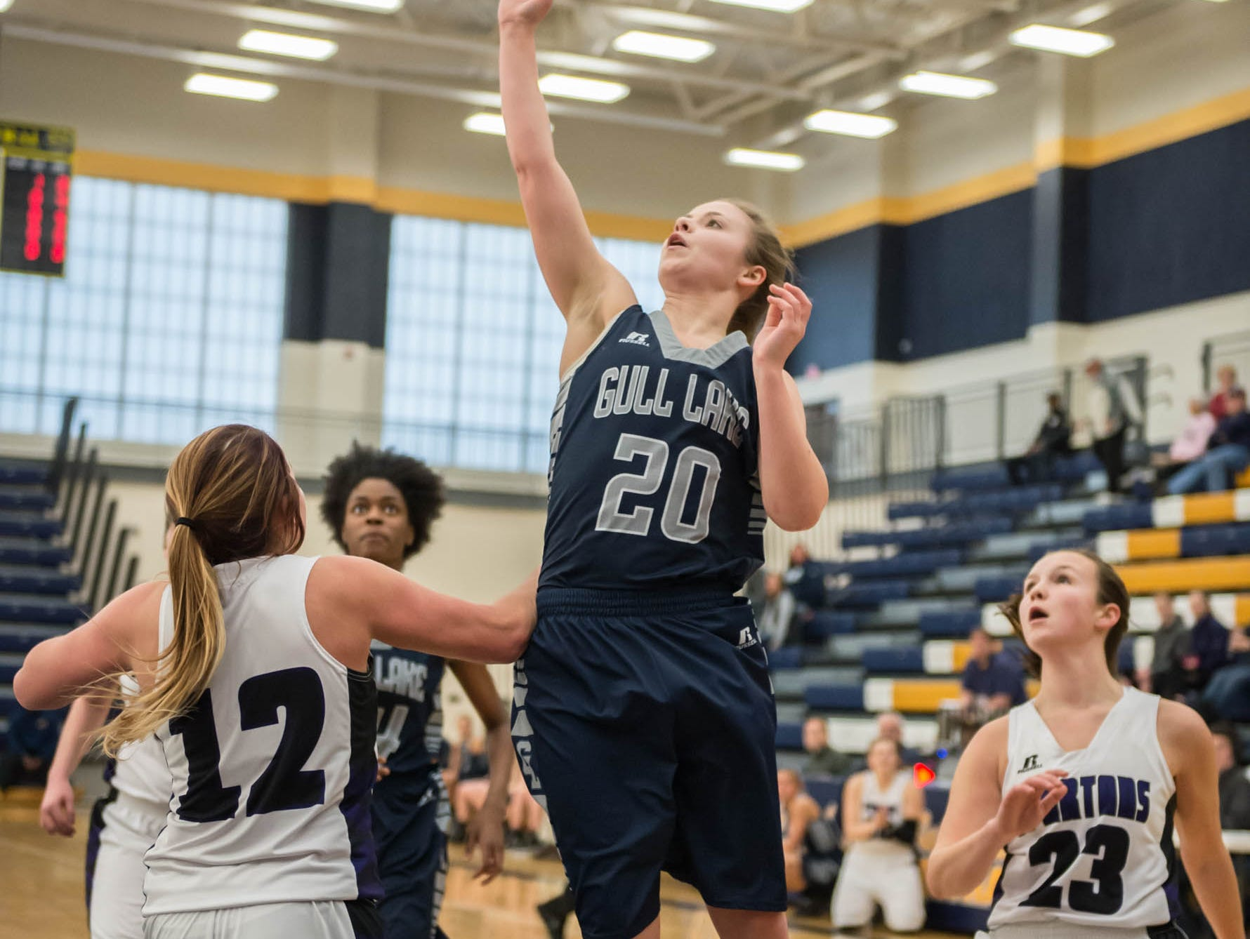 Gull Lake's Madi Bradley (20) takes her shot during district game Wednesday evening against Lakeview.