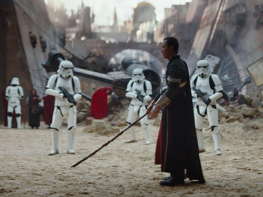 Chirrut Imwe (Donnie Yen) prepares to tussle with a battalion of Stormtroopers in 'Rogue One.'