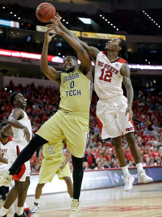 Georgia Tech's Charles Mitchell (0) drives to the basket as North Carolina State's Anthony Barber (12) defends during the second half of an NCAA college basketball game in Raleigh, N.C., Wednesday, Jan. 27, 2016. Georgia Tech won 90-83. (AP Photo/Gerry Broome)