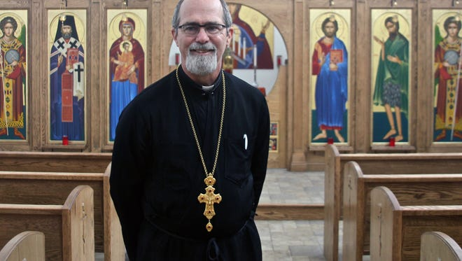 Father David Kruse poses for a photograph in the sanctuary of St. Raphael Orthodox Christian Church on Wednesday, Dec. 2, 2015. Located in Thousand Palms, the church was founded by a family of Syrian refugees.