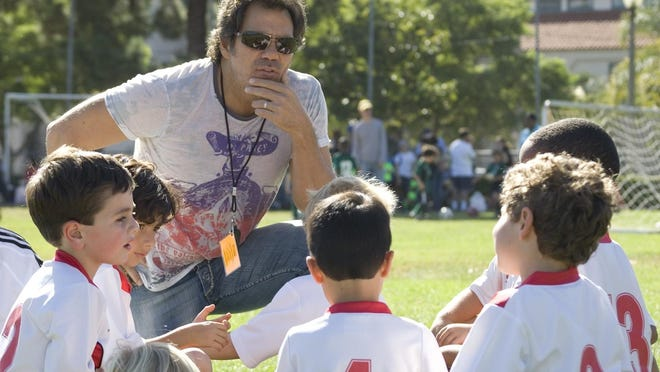 Tom Gores found coaching youth teams offered him an opportunity to spend extra time with his children, now teens.