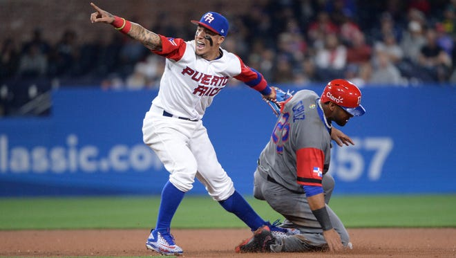 Dominican Republic outfielder Nelson Cruz is forced out at second base by Puerto Rico infielder Javier Baez during the  World Baseball Classic at Petco Park.