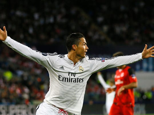 Real Madrid's Cristiano Ronaldo celebrates after scoring the second goal during the UEFA Super Cup soccer match between Read Madrid and Sevilla at Cardiff City Stadium in Wales Tuesday, Aug. 12, 2014. (AP Photo/Kirsty Wigglesworth)