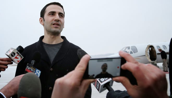 Former U.S. Marine Amir Hekmati, 32, talks to the media after arriving at Bishop International Airport on Thursday, Jan.  21, 2016, in Flint,.