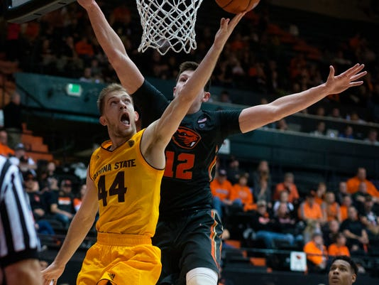 Arizona State's Kodi Justice (44) tries to shoot around Oregon State's Drew Eubanks (12) during the second half of an NCAA college basketball game in Corvallis, Ore., Saturday, Feb. 4, 2017. Arizona State won 81-68. (AP Photo/Timothy J. Gonzalez)