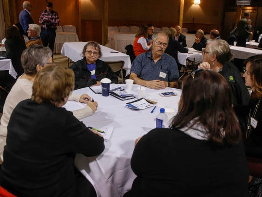 A group brainstorms ideas on how to make smaller communities