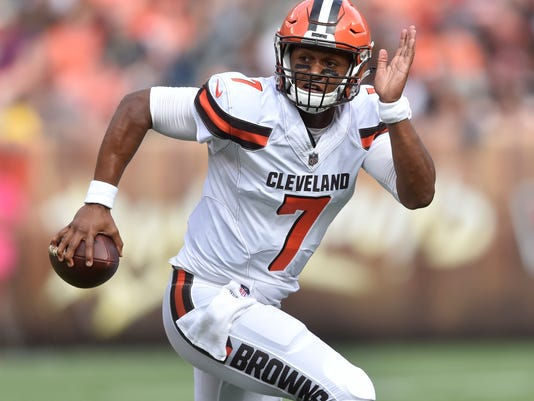 FILE - In this Oct. 8, 2017, file photo, Cleveland Browns quarterback DeShone Kizer (7) runs with the ball during an NFL football game against the New York Jets, in Cleveland. The Browns play the Titans in Cleveland on Sunday. (AP Photo/David Richard, File)