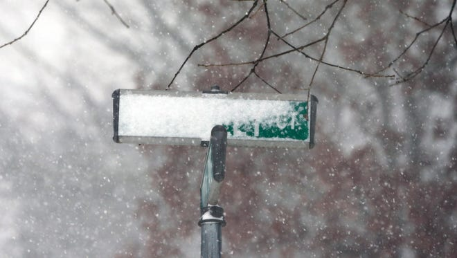 Strong winds whip a driving snow around the Herbertsville section of Brick early this morning as the  Blizzard of 2016 continues to dump snow into the North East on Saturday January 23, 2016.Snow covers a street sign along McKinley Ct in Brick.