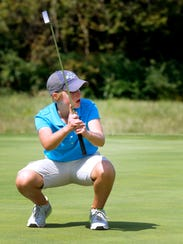 Siegel's Susannah Blackwell reacts to a putt during the district tournament. Blackwell is a finalist for All-Area Girls Golfer of the Year.