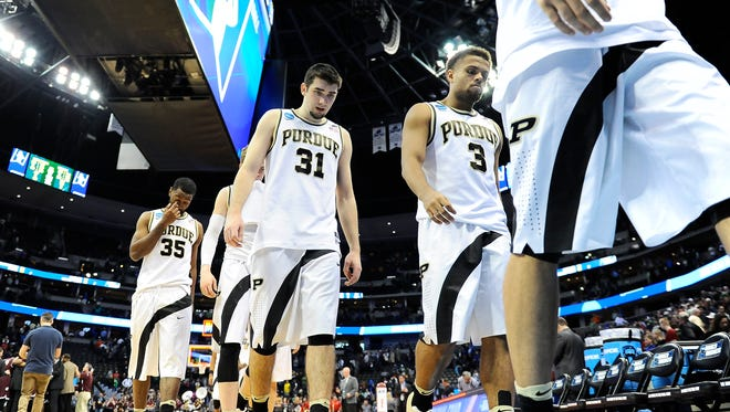 Purdue Boilermakers players leave the court after loosing to Arkansas Little Rock Trojans 85-83 during Purdue vs Arkansas Little Rock in the first round of the 2016 NCAA Tournament at Pepsi Center.