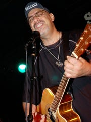 Pat DiNizio of the Smithereens, pictured performing