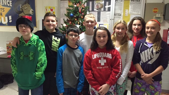 (From left) Blaine Power, Josh Gardella, Ian Hoban, L.J. Leidy, Alicia Green, Sadie Parks, Cassie Magliocco and Cheyenne Kanuck, members of the Counselor's Helpers at Caroline L. Reutter School, held a coat drive during December. The coats were collected for members of the community who needed assistance during the winter months. More than eight bags of coats for men, women and children were collected, sorted and donated.