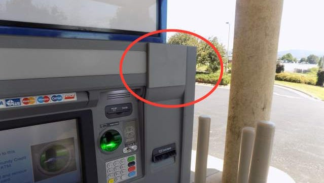 A seemingly innocuous square box recently affixed to the top right-hand corner of this ATM at the DuPont Community Credit Union in Waynesboro is actually a camera used to steal PIN numbers, police said. The card reader on the ATM is also fake and is a skimming device used to steal card data.