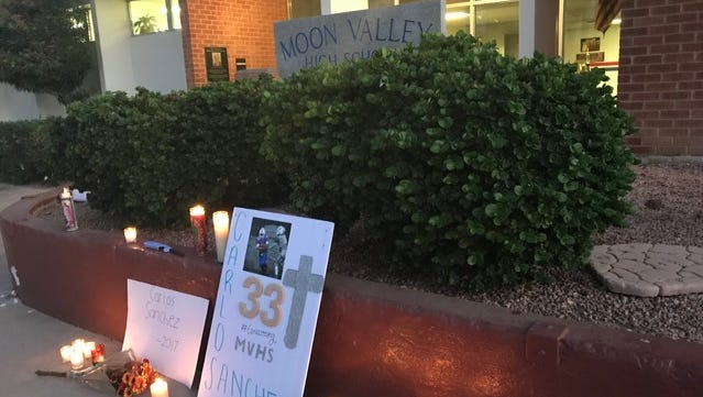 Friends and fellow students held a vigil Sunday evening at Moon Valley High School to honor their classmate, Carlos Sanchez, who died two days after collapsing on the football field Friday.