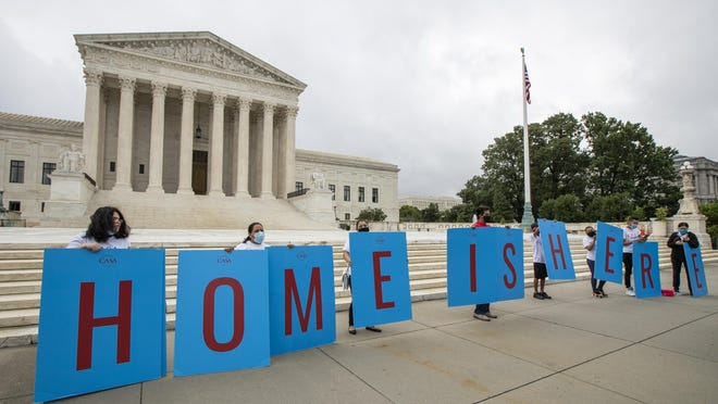 Deferred Action for Childhood Arrivals (DACA) students gather in front of the Supreme Court on June 18 in Washington.