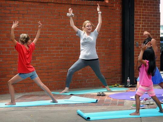 Kaeli Fowler of the Wichita Falls Yoga Center conducts a Kids Yoga class Tuesday morning at the Farmers Market downtown.