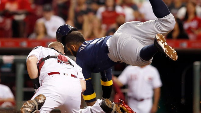 Brewers shortstop Jonathan Villar is tagged out at home by Reds catcher Tucker Barnhart in the seventh inning.