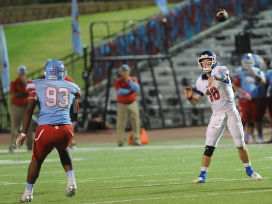 Cooper quarterback Ender Freeman, right, throws a pass