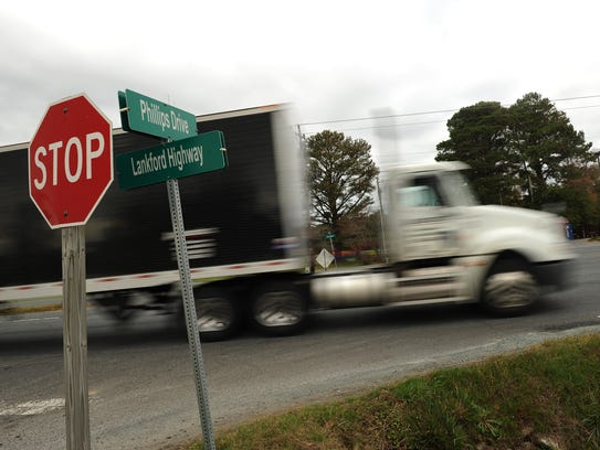 A tractor trailer passes through the intersection of