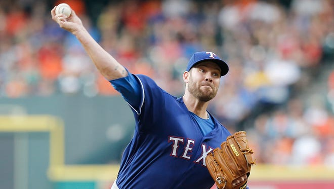 Texas Rangers starting pitcher Colby Lewis (48) pitches against the Houston Astros in the first inning at Minute Maid Park.