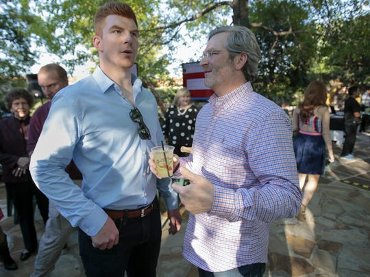 Andy Dalton talks with his dad Greg (right) during a fundraising event for the Andy and Jordan Dalton Foundation.