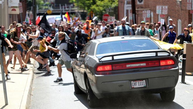 A vehicle drives into a group of protesters demonstrating against a white nationalist rally in Charlottesville, Virginia, Aug. 12. One of the protesters was killed and several were injured.