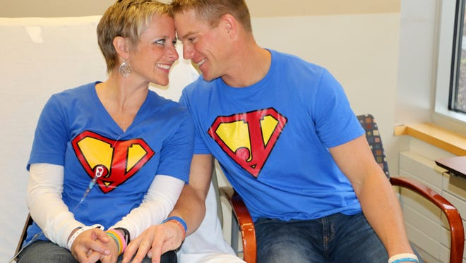 Jessica Dilts-Cash receives chemotherapy at Karmanos Cancer Institute in Farmington Hills.  Her husband, Aaron Cash, is at her side.