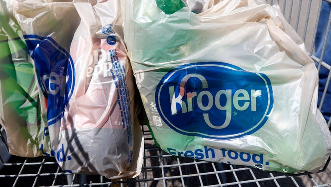 Bagged purchases from a Kroger sit inside a shopping cart, June 15, 2017.
