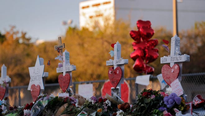 This Feb. 19, 2018, file photo shows a makeshift memorial outside Marjory Stoneman Douglas High School, where 17 students and faculty were killed in a mass shooting in Parkland, Fla. Parkland's historian Jeff Schwartz is setting a plan in motion to collect, archive and preserve the Marjory Stoneman Douglas mementos. Meanwhile, school administrators have vowed to build a memorial after the demolition of the building where the Feb. 14 attack took place.