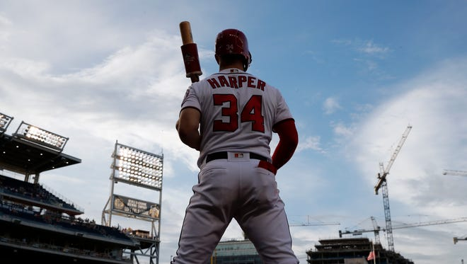Washington Nationals center fielder Bryce Harper (34) waits to bat during a baseball game against the Cincinnati Reds at Nationals Park, Thursday, Aug. 2, 2018, in Washington.