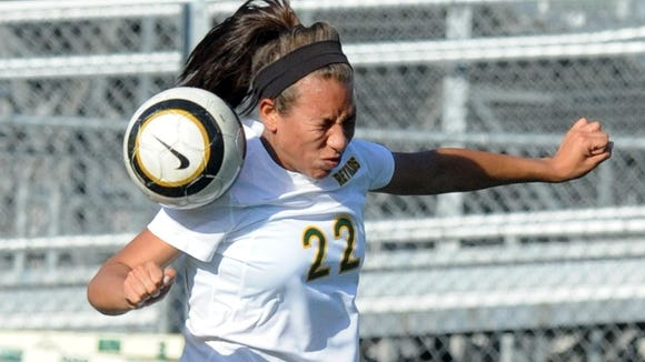 Reynolds senior Breona Tate (22) and the Rockets will be home for Saturday's fourth round of the NCHSAA 3-A soccer playoffs.