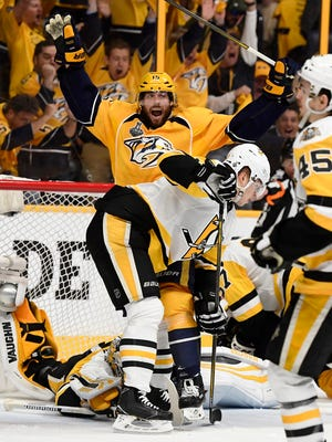 Predators right wing Craig Smith (15) celebrates the goal by center Calle Jarnkrok (not shown) during the first period of Game 4 of the Stanley Cup Final on Monday, June 5, 2017.