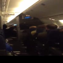 This image comes from a flier's video showing turbulence on American Airlines Flight 280.