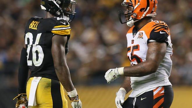 Pittsburgh Steelers running back Le'Veon Bell (26), left, and Cincinnati Bengals outside linebacker Vontaze Burfict (55) talk in the third quarter during the Week 7 NFL game between the Cincinnati Bengals and the Pittsburgh Steelers, Sunday, Oct. 22, 2017,  at Heinz Field in Pittsburgh.