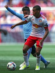 Wappingers Falls' Tyler Adams, hours after graduating from Roy C. Ketcham High School, is pictured keeping the ball away from New York City Football Club forward David Villa for the New York Red Bulls on Saturday in Harrison, New Jersey.