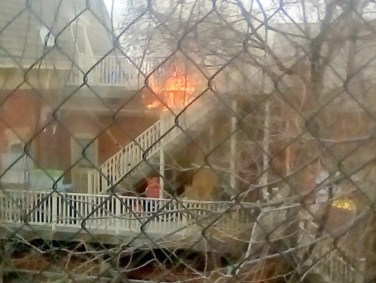 Fire comes out of one of the apartments at the Conway