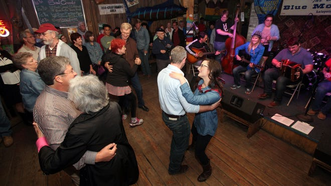 Dancers move to the music during the UL Traditional Music Showcase Tuesday, April 28, 2015, at Blue Moon Saloon in Lafayette, La.