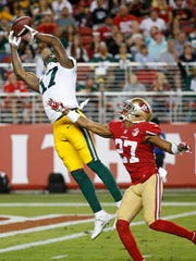 Green Bay Packers wide receiver Davante Adams misses a pass from quarterback Joe Callahan as San Francisco 49ers cornerback Keith Reaser defends.