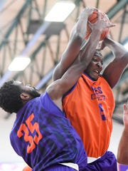 University of Evansville's John Hall (35) and Dalen Traore (15) fight for a rebound during a intrasquad scrimmage at the HoopFest season tipoff at the Meeks Family Fieldhouse on October 25.