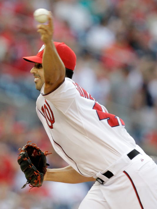 Washington Nationals pitcher Gio Gonzalez throws the ball during the first inning of a baseball game against the the New York Mets, Tuesday, Aug. 5, 2014, in Washington. (AP Photo/Luis M. Alvarez)