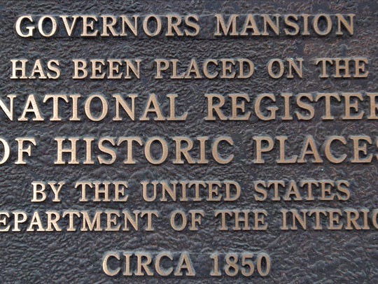 Plaque placed on Governor's Mansion in Opelousas.