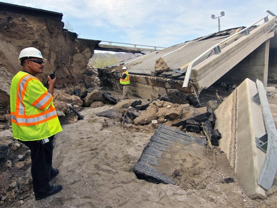 Caltrans workers on Monday investigate the collapse of the 48-year-old Tex Wash Bridge on Interstate 10 near Desert Center, Calif.