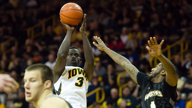 Iowa Hawkeyes guard Peter Jok (3) attempts a shot against the UMBC Retrievers at Carver-Hawkeye Arena. Iowa won 77-47.