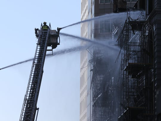 Firefighters were still working after sunrise Saturday to extinguish a fire that began overnight in downtown Des Moines' historic Younkers building.