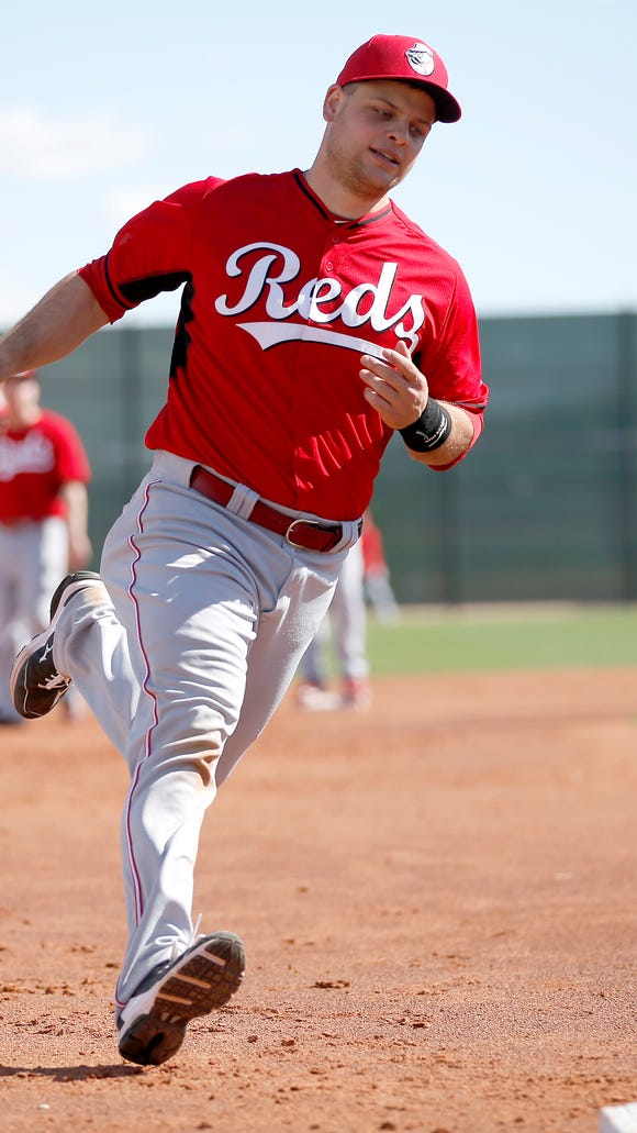 Reds catcher Devin Mesoraco runs toward third base during base running drills Feb. 24 in Goodyear.